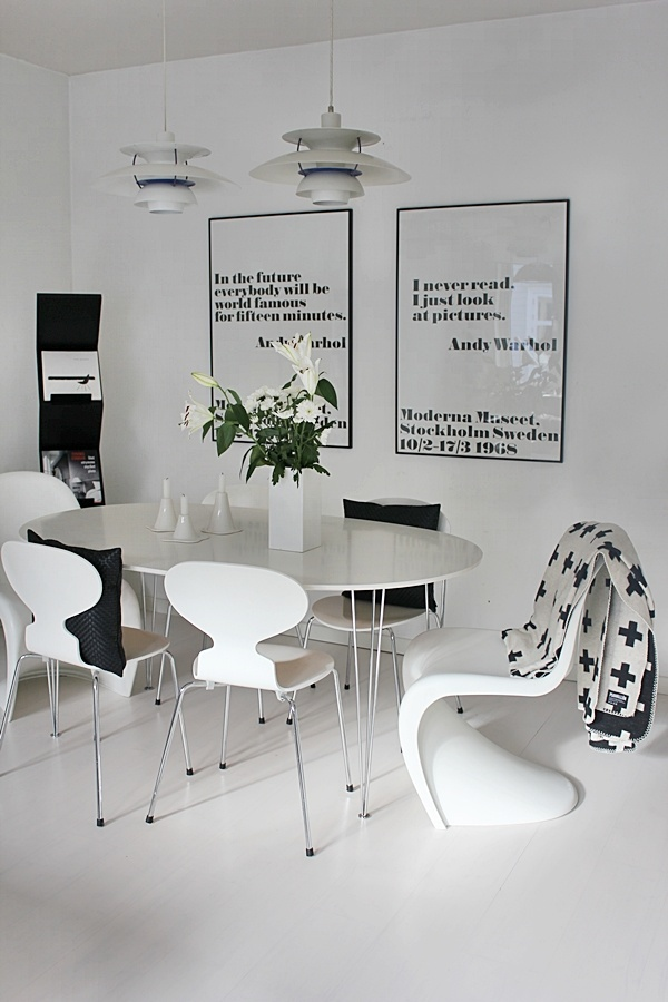 Ant Chair, Panton Chair, Super Ellipse and PH 5-4½ Charlottenborg Lamp. Prints are the perfect accessory for black and white interiors.