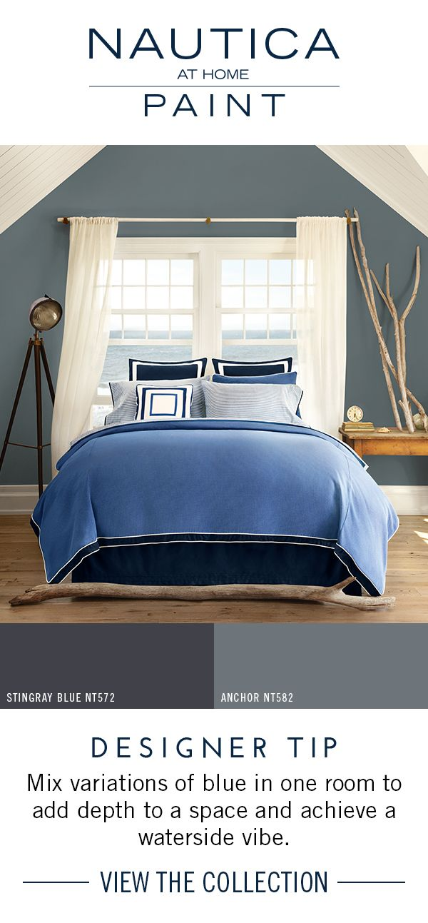 An Endless Sea of Blue Bedroom | Mix variations of blue in one room to add depth to a space and achieve a waterside vibe. The dark blue paint color here acts as a subtle backdrop in the space, while the repetition of colors provides cohesive flow. Find these paint colors and more collections by Nautica at Home at http://www.nauticapaint.com/
