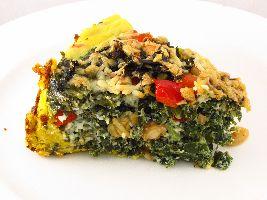 Zo heb je vast nog nooit boerenkool gegeten: Hartige quiche met deeg van pompoen en amandelmeel en vulling met boerenkool. Voedselzandloper-proof!
