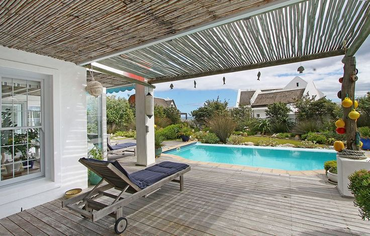 Self catering accommodation, Kommetjie, Cape Town   Pool and patio area  http://www.capepointroute.co.za/moreinfoAccommodation.php?aID=483
