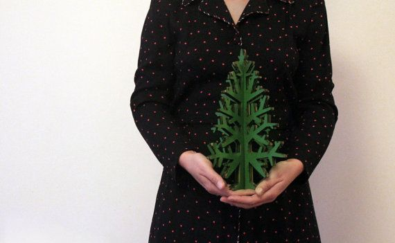 Send a little holiday cheer to dorm-dwellers and folks in small apartments with this modern cardboard tree decoration.