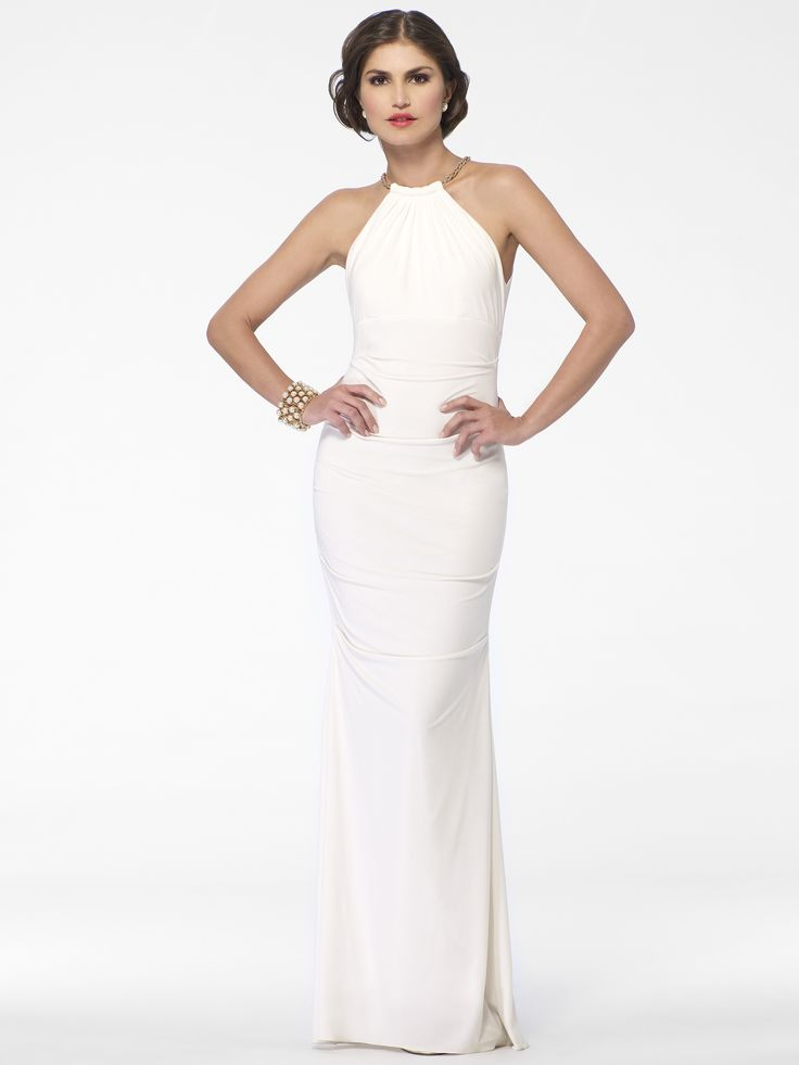 This Cache gown is so simple yet stunning! I love the all white. I would wear it with red lipstick and a crystal necklace.  I plan to create an all white gown collection one day.