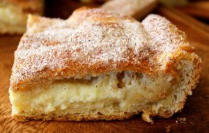 Churro Cheesecake Bars make look intimidating to make, but they are far from it. They're easy to put together, and are so worth it. The cinnamon sugar is a delight for the mouth, and the soft cream cheese filling is pure enjoyment. The two sheets of crescent rolls sandwich the filling and make this treat possible. This unique dessert is one you don't want to miss. It may be the best recipe for churros you ever eat!