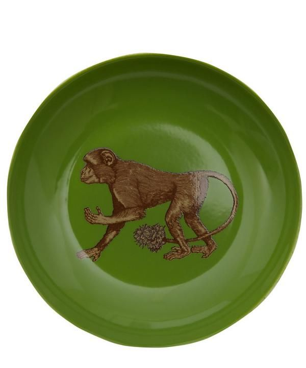 This surprisingly functional porcelain plate features a colourful interior glaze and animal illustration.