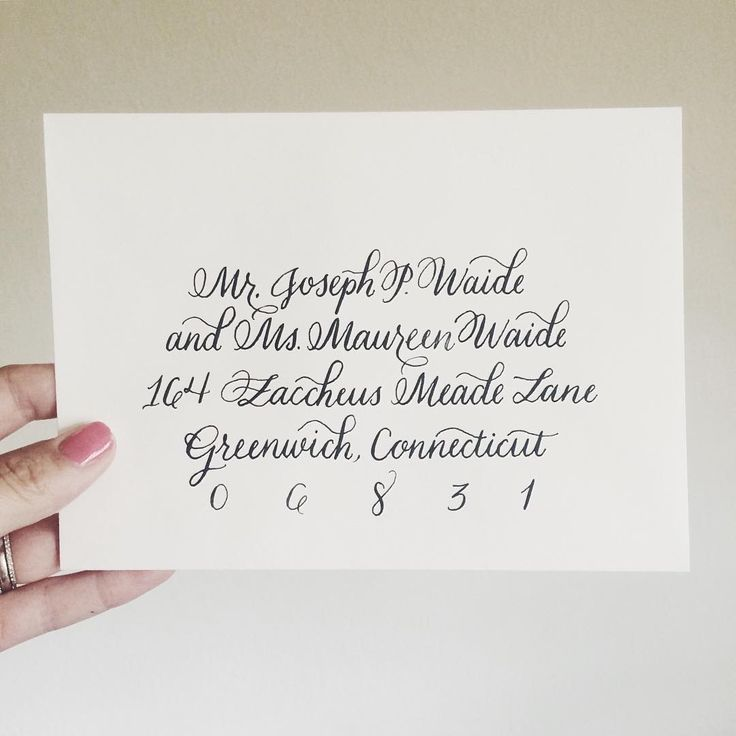 Traditional style Modern Calligraphy navy on cream wedding envelope addressing by The Curly Quill Calligraphy