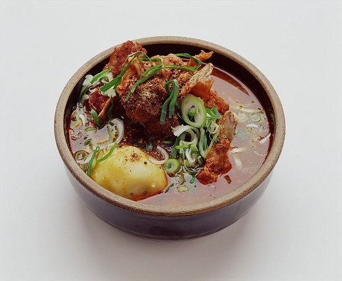 Gamjatang, pork-on-the-bone soup with potatoes: Pork backbone soup, made with potatoes, green cabbage leaves, and aromatic wild sesame seeds.   [Sorry, NO RECIPE]