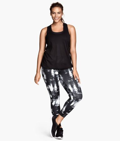 H&M+ Sports Tights Ankle-length sports tights in fast-drying, functional fabric. Wide ribbed waistband with concealed mesh key pocket.  L, XL, 2X, 3X $29