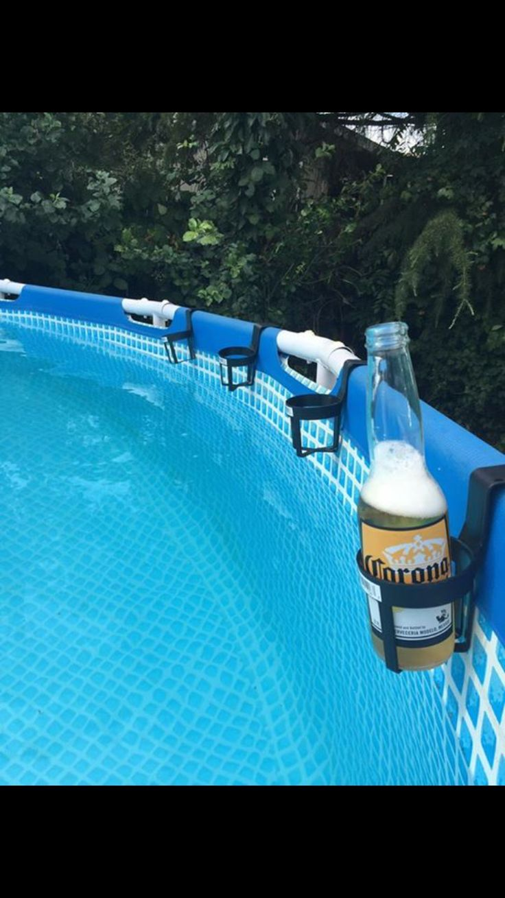 SUMMER HACK! Use $0.99 car cup holders around the edge of an above ground pool for easy drink access.     Pool hack. Pool drink holder. Swimming hack. Cheap drink holder