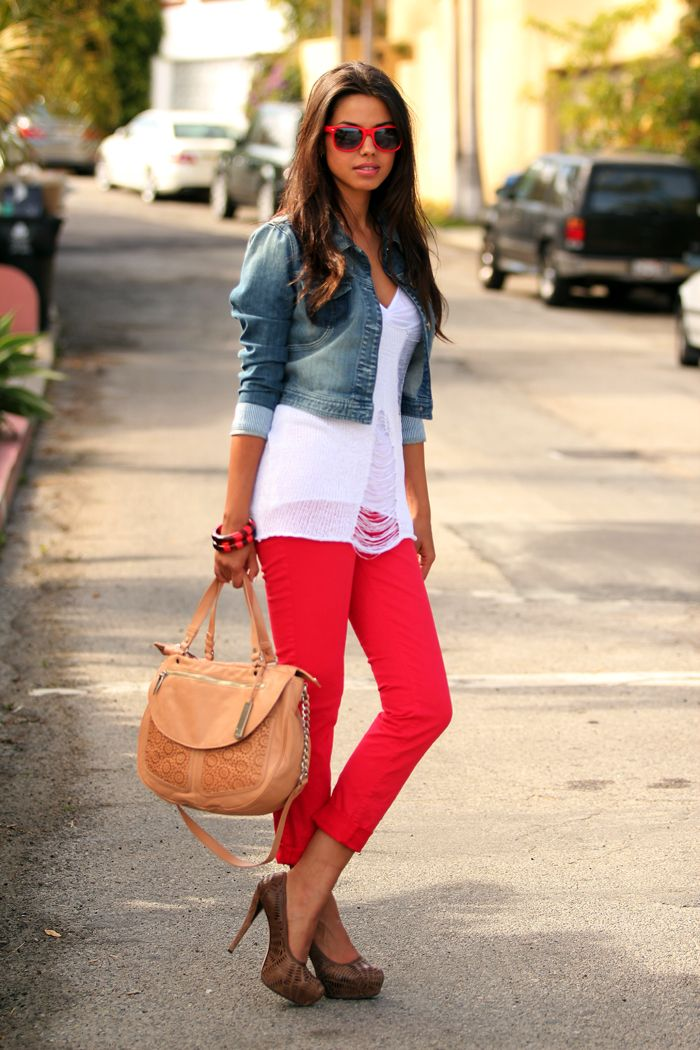 white top with cropped denim jacket and red jeans