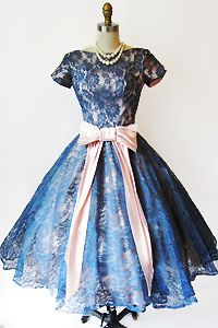 I'm in love with this dress..   Yes, lots of dresses in the 50's and early  60's were fashioned after this look.  Love the sleeves.  What a beautiful bridesmaids dress this would make, also.