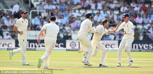 England spinner Liam Dawson celebrates taking the key wicket of Hashim Amla