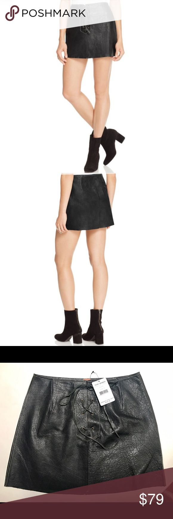 """Free People Join Hands Leather Skirt Trendy, lace-up styling endows Free People's lustrous leather mini skirt . Wear yours with a concert tee or a slouchy boyfriend sweater for a double-dose of downtown cool. Leather Professional leather clean Fits true to size, order your normal size Designed for a contemporary fit Lace-up front, contrast stitching, darted Approx. 14.5"""" from back of waist to hem, based on a size 4 Free People Skirts Mini"""
