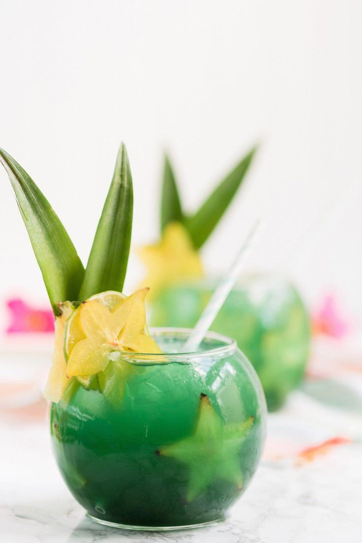 Mermaid Water FIsh Bowl Drinks | Summer cocktail recipes, summer party ideas, re…