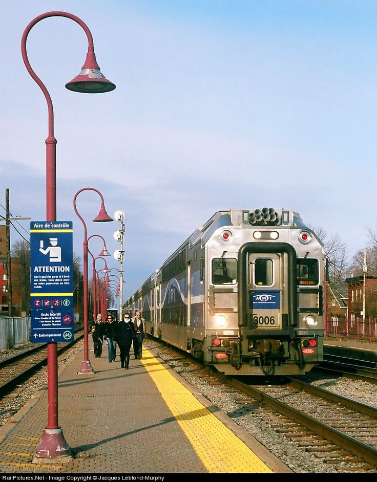 After making its stop at Montreal West, outbound train 111 departs for Hudson as commuters head for the streets.