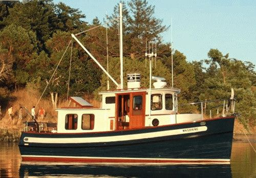 Nordic Tugs 26cr: There are a number of color options available for the hull of the Nordic Tug 26. This is a picture of one of the old 26s, and we should point out that the side doors are now Diamond Star Glaze and the wood has been eliminated on the new 26cr.