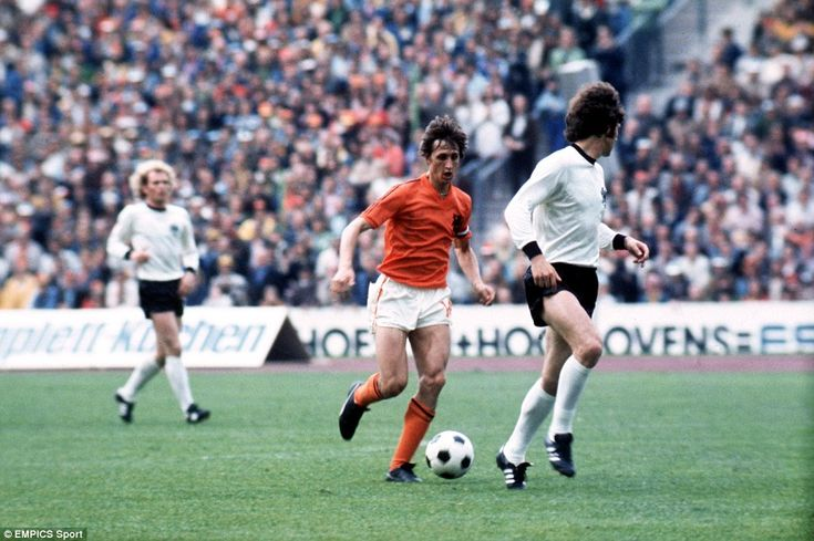 Holland's Johan Cruyff runs at West Germany's Franz Beckenbauer during the 1974 World Cup ...