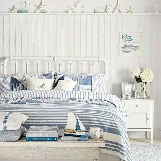 Crisp blue and white striped bedding  and coastal accessories