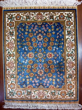 hand knotted turkish carpet silk warp weft pile sky blue. Pile material: 100% silk; Warp: 100% silk Weft: 100% silk. Width:45cm, length:61cm. I really love the intricate motifs in this design.