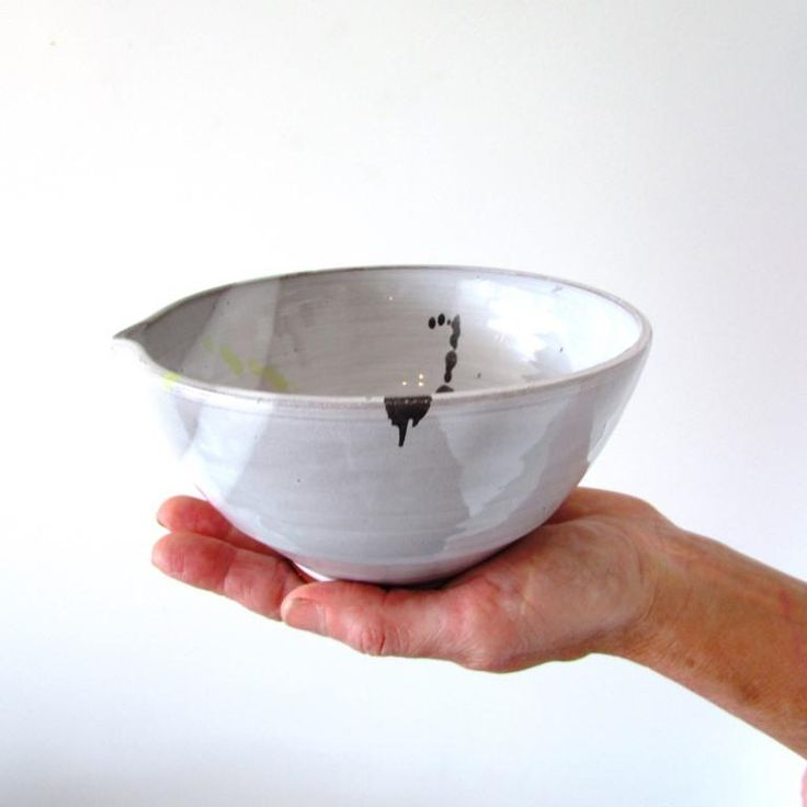This is a medium large bowl with a pulled pouring lip.  I love the old fashioned French bowls and this has a slight essence of those.  It is a perfect size for a wee salad for 2 or a greedy helping of pasta for you! It is made from red terracotta clay with a coating of white shiny glaze where the cl...
