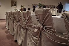 You can make your own cheap wedding chair covers with a rectangular piece of tulle