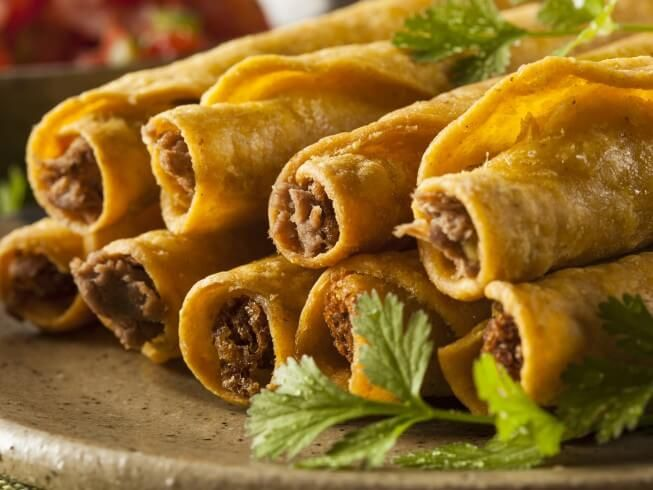 A 5-star recipe for Baked Ground Beef Taquitos made with vegetable oil, ground beef, white onion, cumin, ground coriander, chili powder, salt