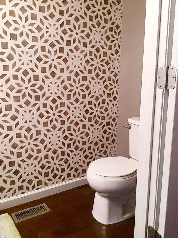 A half bathroom that was decorated with a stenciled accent wall using the Kerala Allover Stencil from Cutting Edge Stencils. It's a geometric Indian inspired wall pattern. http://www.cuttingedgestencils.com/kerala-indian-stencil-geometric-pattern-stencils.html