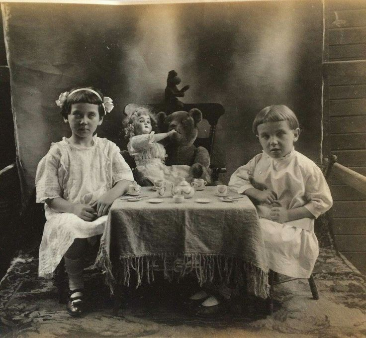 A photo of the Borst children. Sister & brother having a tea party with their doll and bear.  Taken: 1914 in Kenhorst, Berks County, PA
