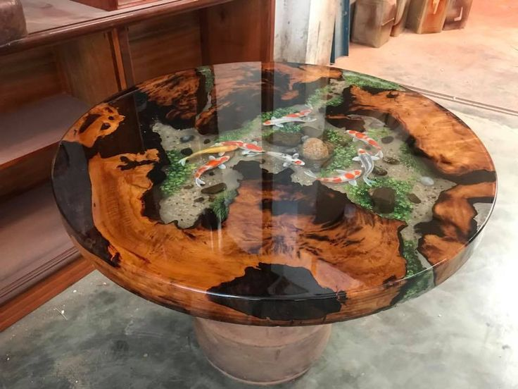 Type of wood: Menghundor Time to make: The entire process is handmade in 1 month Size: 80cm (diameter) x 5cm (thickness) This craftsmanship achieved through the process of encapsulation with resin polyester, preserving the natural beauty of the tree, increase the range of colors as