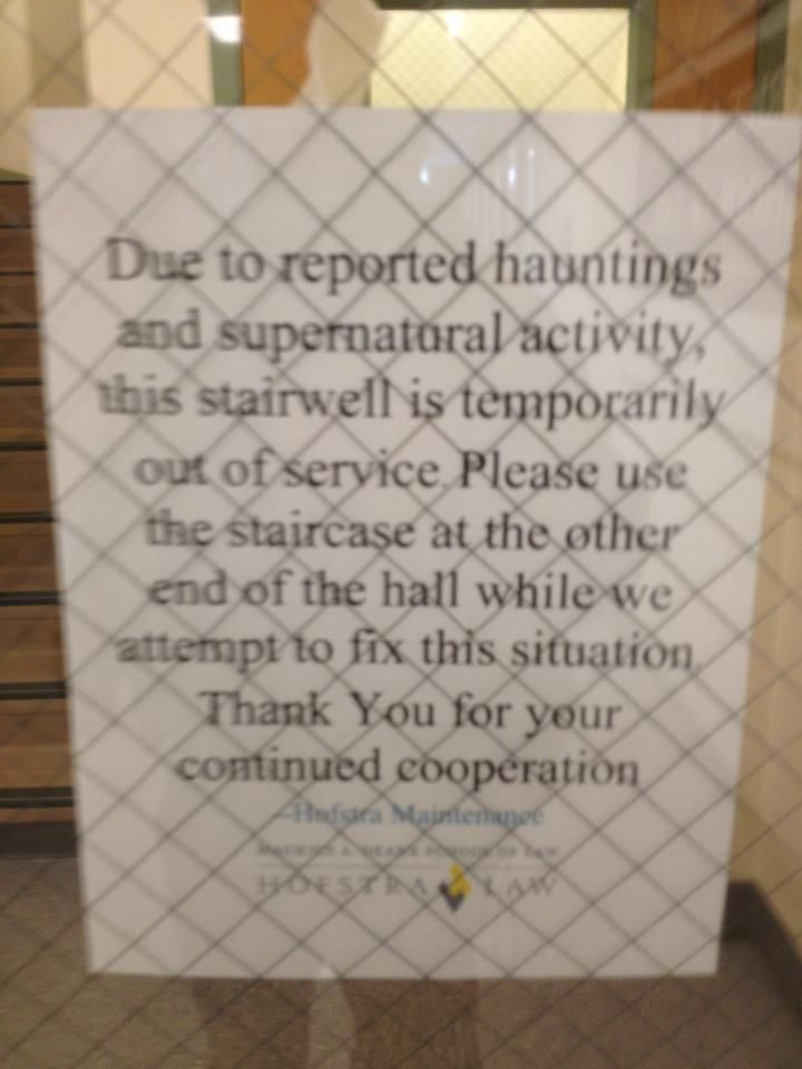 Sign in law school makes being in a building full of future lawyers even more terrifying. Don't think this is 100% serious, or else the janitors are ghostbusters.