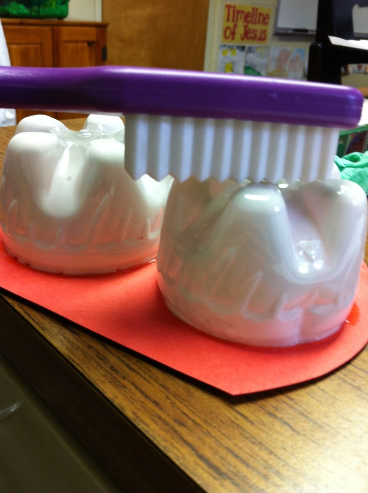 Teeth made from bottom of plastic soda bottles to teach a lesson on what sides of teeth need to be brushed and on how to floss using yarn for floss and tissue paper for food particles.