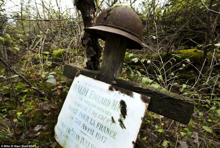 Grave of French soldier Edouard Ivaldi in Champagne. This is the only grave left from WW1 and still has Ivaldi's helmet marking the spot he fell in 1917