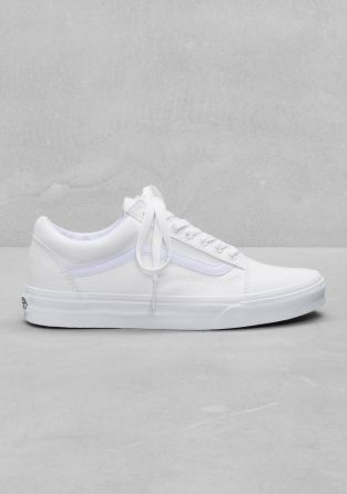 VANS Lace-up textile sneakers in classic white hue. These 'old school'- influenced shoes have the brand-logo attached on the back of the heel.