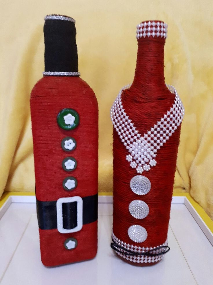 Modern father Christmas & mama Christmas decorated wine bottles