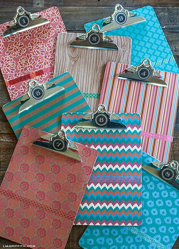 Covered clipboards (paper, modge podge, washi tape, & stickers).  Can be used for photos, lists, reminders, etc