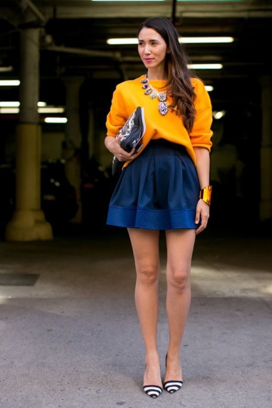 Colorblock look: Orange sweater, navy blue skirt, statement necklace and black & white striped heels @ NYFW - Spring 2014 runaway shows