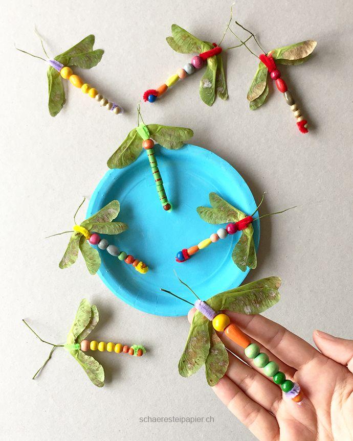 Hier wimmelt es noch von Libellen, obwohl es schon September ist. Diese Kindergarten-Bastelarbeit ist schnell und einfach gemacht un...
