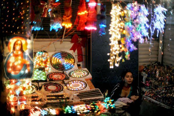 EL SALVADOR IS GREAT PLACE TO BE DURING THE HOLIDAY. PEOPLE HERE DANCE AND EAT, AND THE CHILDREN PLAY WITH SPARKLES