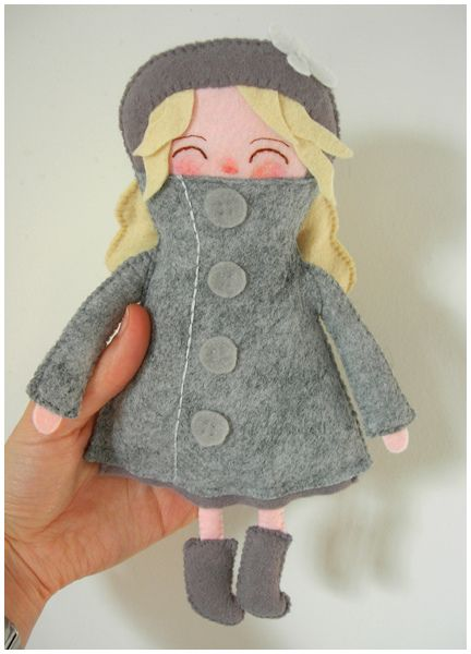 Little blonde doll wearing a gray wool felt jacket with matching beret. Love how her cheeks are even rosy, as if she'd been outside playing. Cute!