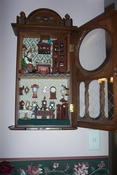 "~ Julie Craig ~ I bought this old clock case from an op shop for 5 dollars!!! I ripped out the non-working parts and made a clock shop and the clock maker lives upstairs. His name is Mr Tock and his little doggie is named ""Tick""!"