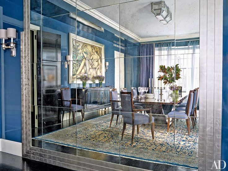 Interior designer Victoria Hagan coated a New York dining room with a sapphire-blue by Pratt & Lambert. The room, which was created with Peter Pennoyer Architects, includes an Émile-Jacques Ruhlmann table, French Art Deco chairs, and a De Coene Frères buffet, which is from Karl Kemp Antiques.