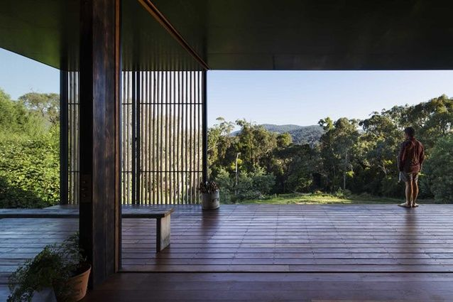 The slatted timber screen opens and extends along the outer edge of the deck.