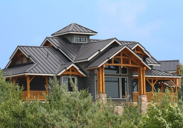 dark blue wood siding house with a metal roof - AMAZING