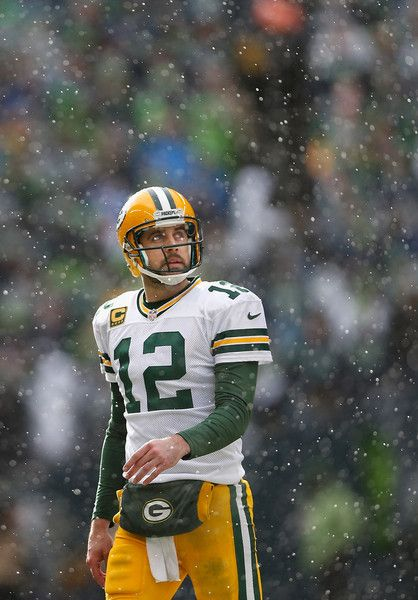 Quarterback Aaron Rodgers #12 of the Green Bay Packers walks off the field during the 2015 NFC Championship game against the Seattle Seahawks at CenturyLink Field on January 18, 2015 in Seattle, Washington. The Seahawks defeated the Packers 28-22 in overtime.