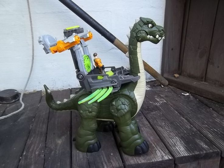 "Good used condition, noise and sound works as it should, comes with armor and figurine, missing missiles, Very Large Toy, over 15"" tall.<br/><br/>This Fisher-Price Imaginext Mega Apatosaurus walks and roars like a real dinosaur! Plus, this one comes with cool transforming tech armor at the press of a button! Requires 4 AA batteries. Missing projectiles for cannons."