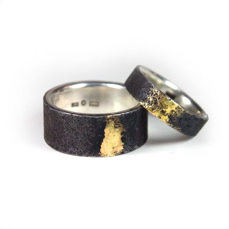 iron and silver wedding ring with golden soldering