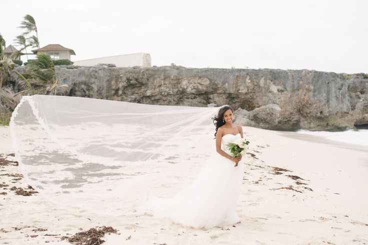 WOW! That long wedding veil is the most stunning accessory ever - and so perfect for beach wedding photos!