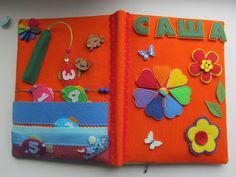 Dimensions of the quiet book: 23х17 cm. It consists of 2 pages + cover and includes: -Rainbow-flower (velcro) - learning colors, 2 flowers - knob and button -Seasons (velcro, hooks and snaps) – learn seasons and weather -Maze to develop fine motor skills, hand-eye coordination