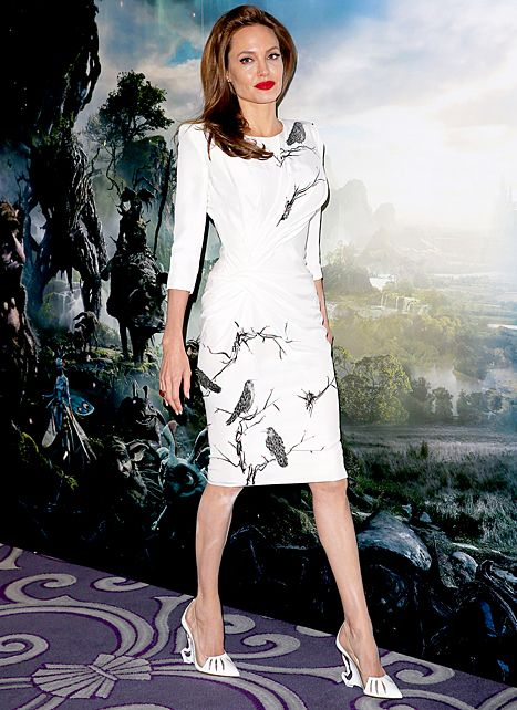 Angelina Jolie, wearing custom Christian Louboutin shoes, attends a photocall for Maleficent at Corinthia Hotel London on May 9, 2014 in London, England.