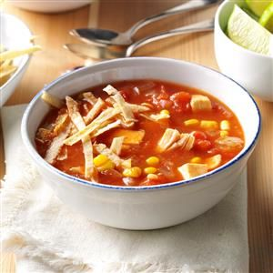 Spicy Chicken Tomato Soup Recipe -Cumin, chili powder and cayenne pepper give my slow-cooked specialty its kick. I serve bowls of it with crunchy tortilla strips that bake in no time. Leftover soup freezes well for nights I don't feel like cooking. —Margaret Bailey, Coffeeville, Mississippi