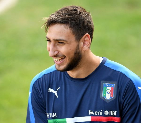 Gianluigi Donnarumma Photos Photos - Gianluigi Donnarumma of Italy smiles during a training session at the club's training ground at Coverciano on October 3, 2016 in Florence, Italy. - Italy Training Session And Press Conference